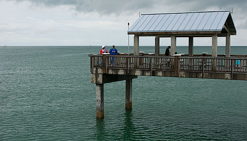A couple of fishermen on the pier