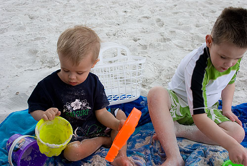 Still playing in the sand.