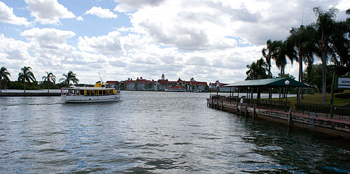 A ferry coming in, with the Grand Floridian resort visible in the distance