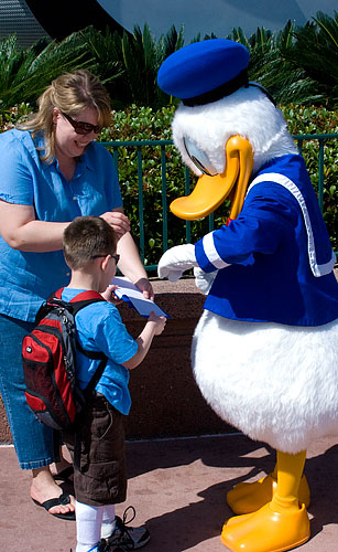 Donald Duck signs Kyle's autograph book