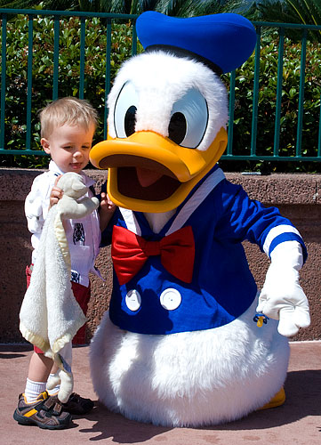 Ian shows Donald his baby.