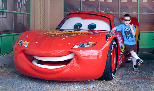 Kyle strikes a pose with Lightning McQueen