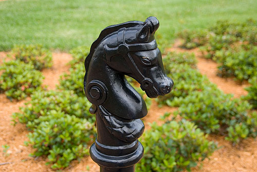 """One of the many horse head post caps scattered around the property. Kyle loved these, and took several photos of each one we passed. Right now he's standing next to me saying, """"Remember that? It's the horsie!"""""""