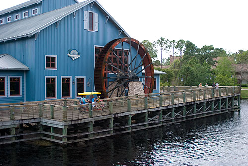 The common area for Port Orleans Riverside. The waterwheel turns a giant axis inside the building, which spins a giant wooden clockwork device in the food court.