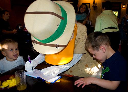 Donald signs Kyle's autograph book