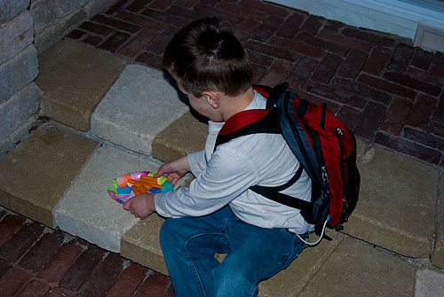 Kyle puts the carrots on the back step for the Easter Bunny
