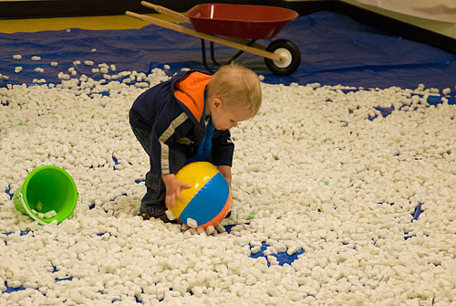 Half of the gym floor was covered in styrofoam peanuts for the kids to play in