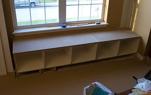 The base cabinets, without the face frame, leveled and ready to be screwed into the wall