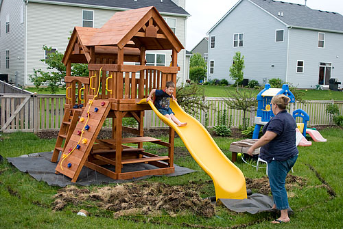 A wide view of the playground. The swings are all that remains to assemble.