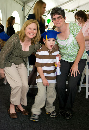 Kyle with his aide, Ms. Debbie (left) and his teacher, Ms. Kate (right)