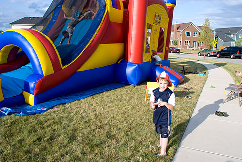 Kyle by the bounce house