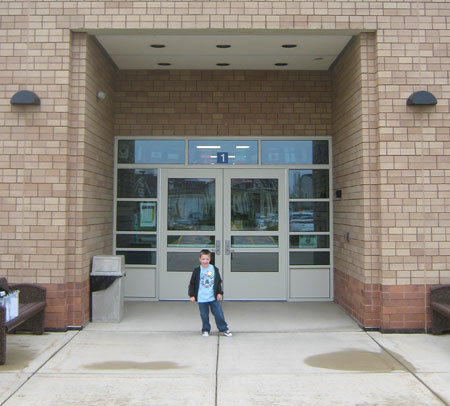 The big kindergartener outside his new school