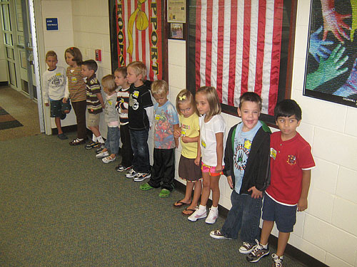 Lining up in the hall with his new classmates