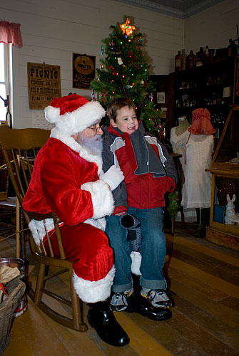 Kyle saw Santa outside the general store from across the yard, then ran full speed all the way there. Once inside he went right to Santa, sat on his lap and told him he wanted 'batman and a slinky' for Christmas.