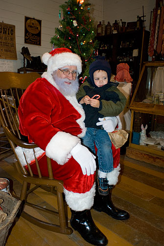 Ian was a little afraid at first, but after Santa had convinced Katra to sit on his lap with Ian on hers, Ian sat on Santa's lap all by himself...