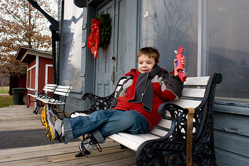 Kyle shows off his cracker outside the general store