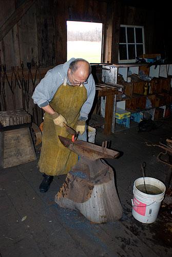 The blacksmith forging a hook