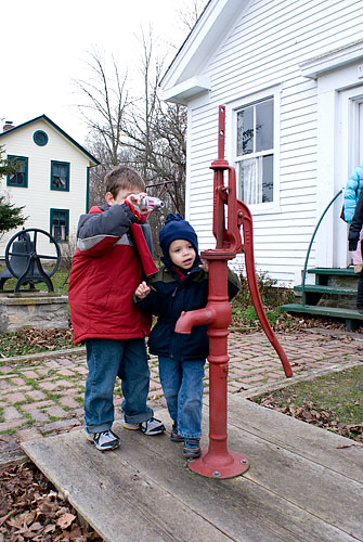 Ian examines the water pump while Kyle (naturally) takes a picture