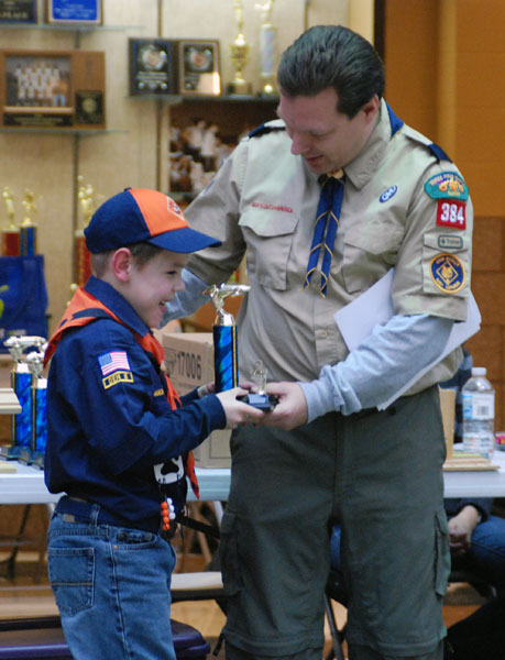 Kyle's car placed second among all the Tiger scouts. Here Kyle receives his trophy.