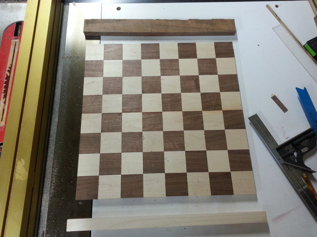 "The board of strips was then crosscut into 2"" widths. The resulting checkered strips were alternated to make the chessboard squares."