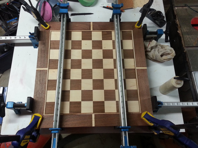 Edges biscuited and glued on. You can never have too many clamps.