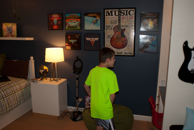 Checking out his new posters. I put some old LPs I had into frames and hung them on the wall.